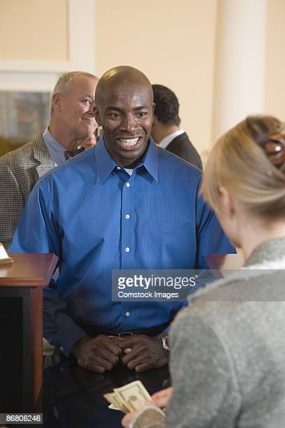 Man in line at bank