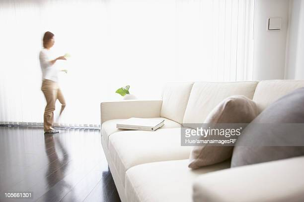 Man in living room, blurred motion, Tokyo prefecture, Japan