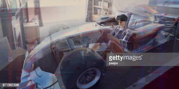 man in living room driving a virtual reality racing car - virtual reality simulator stock photos and pictures