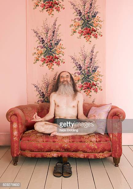 Man in Lotus Position on Couch