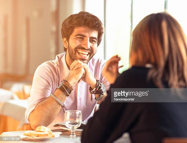 Man in love listening her girlfriend at restaurant -  st.valentine
