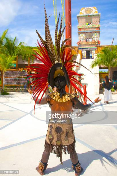 Man in Mayan costume seen from behind