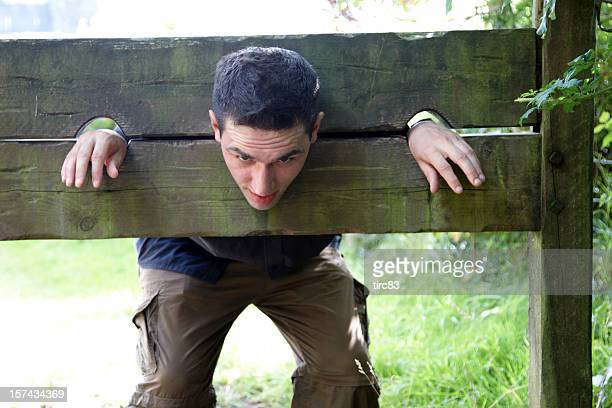 man in medieval stocks - punishment stocks stock pictures, royalty-free photos & images