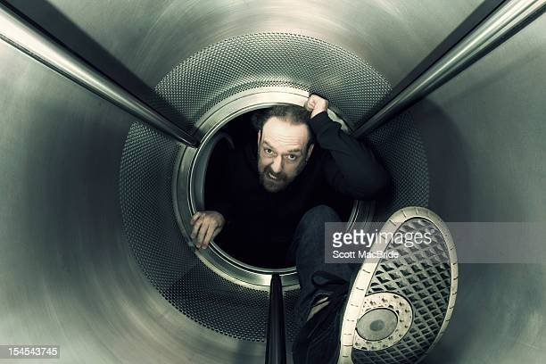 man in metal pipe - scott macbride stock pictures, royalty-free photos & images