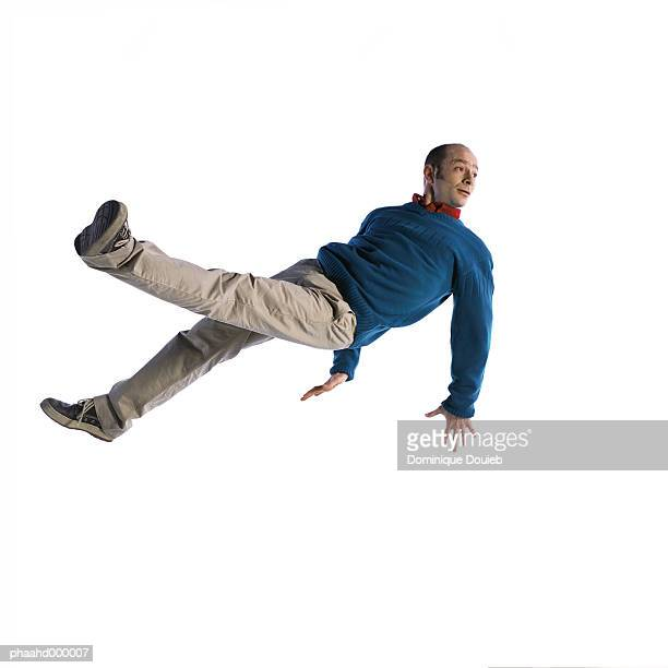 man in mid-air - legs apart stock pictures, royalty-free photos & images