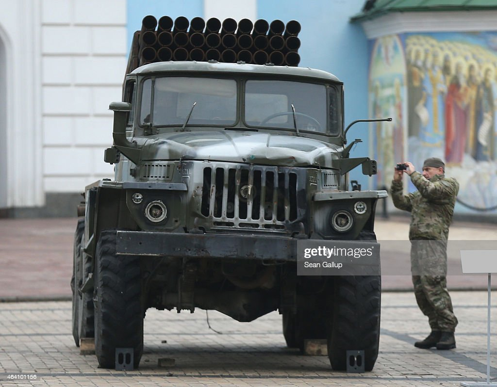 A man in military fatigues photographs a rocket launcher that is part of an exhibition the Ukrainian government claims proves Russian direct involvement in the fighting between Ukrainian troops and pro-Russian separatists in eastern Ukraine on February 22, 2015 in Kiev, Ukraine. Russia has denied sending heavy weaponry to the separatists, admitting only that Russian volunteers are participating in the fighting.