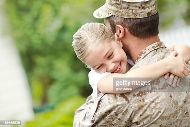 man in military uniform carrying a little girl - army soldier stock photos and pictures