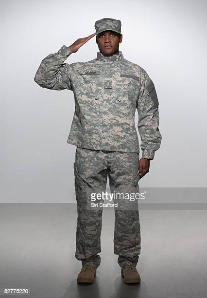 man in military uniform, saluting - army soldier stock photos and pictures