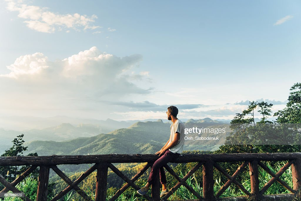 Man in mountains at sunset in Thailand : Stock Photo