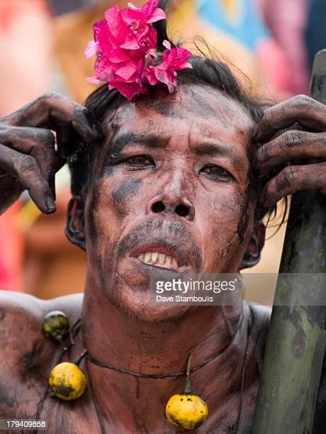 Man in mud having fun, Phi Ta Khon Festival, Thailand