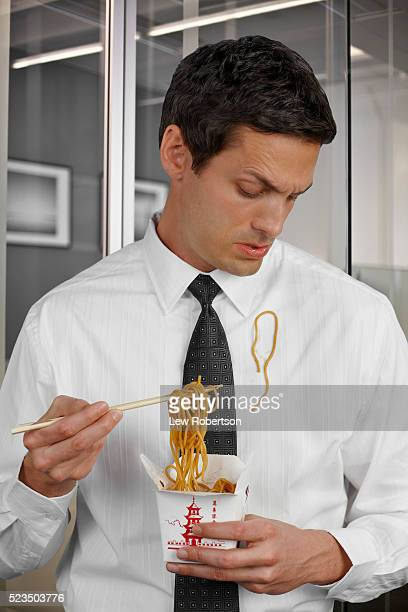 Man in office environment spilling lunch on shirt