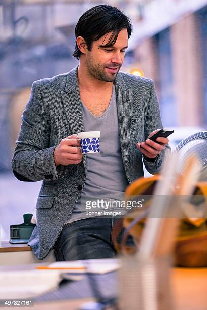 Man in office having coffee break, Gothenburg, Sweden