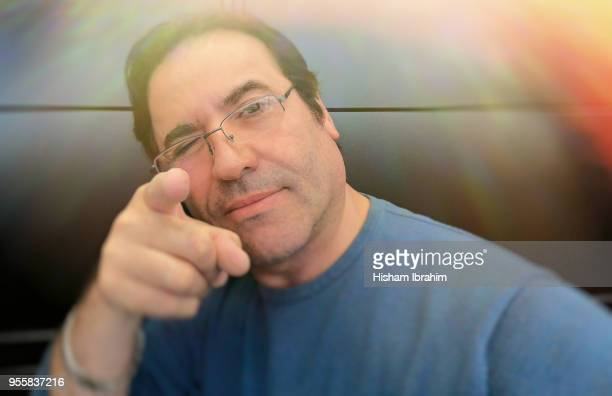 man in office looking at camera and pointing finger - i want you. - aiming stock pictures, royalty-free photos & images
