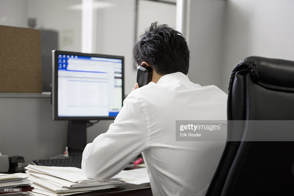 man in office on the telephone : Stock Photo