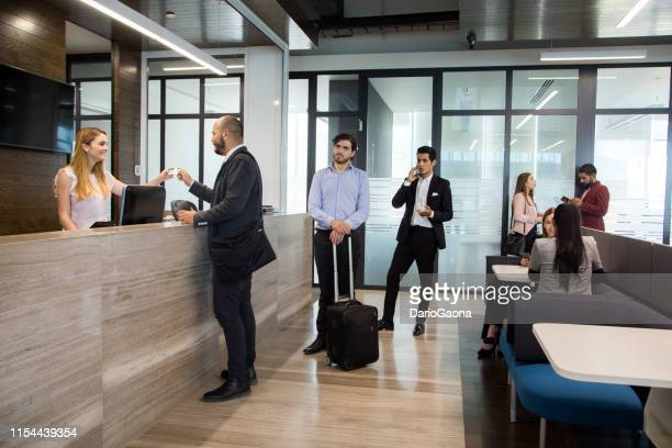man in office reception - receptionist stock pictures, royalty-free photos & images