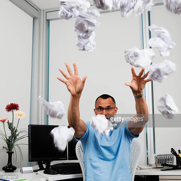 Man in Office Throwing Crumpled Paper