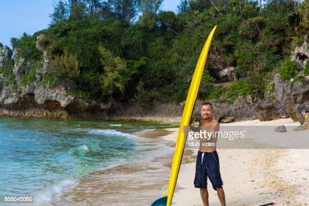 a man in okinawa beach - tdub_video stock pictures, royalty-free photos & images