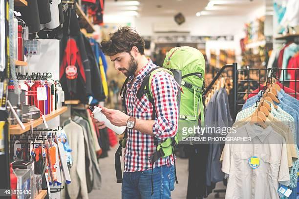 Man in outdoor equipment mega store