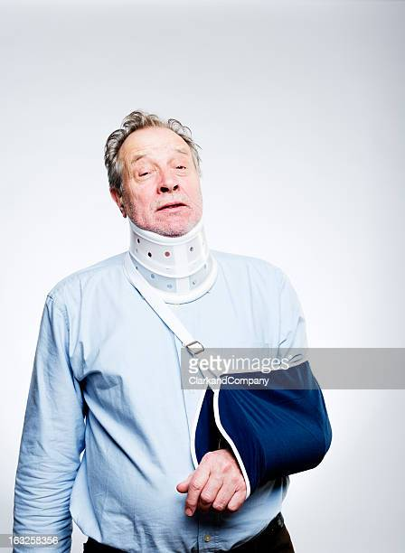 man in pain with whiplash injury wearing  brace and sling - arm sling stock pictures, royalty-free photos & images