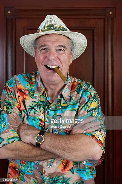 Man in panama hat smoking a cigar