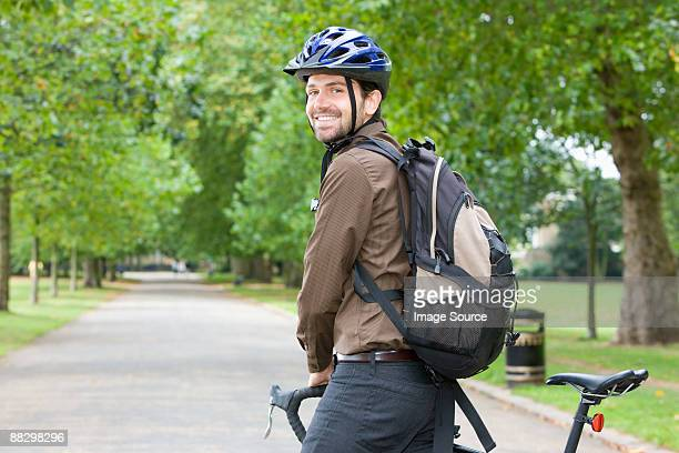 man in park with bike - cycling helmet stock pictures, royalty-free photos & images