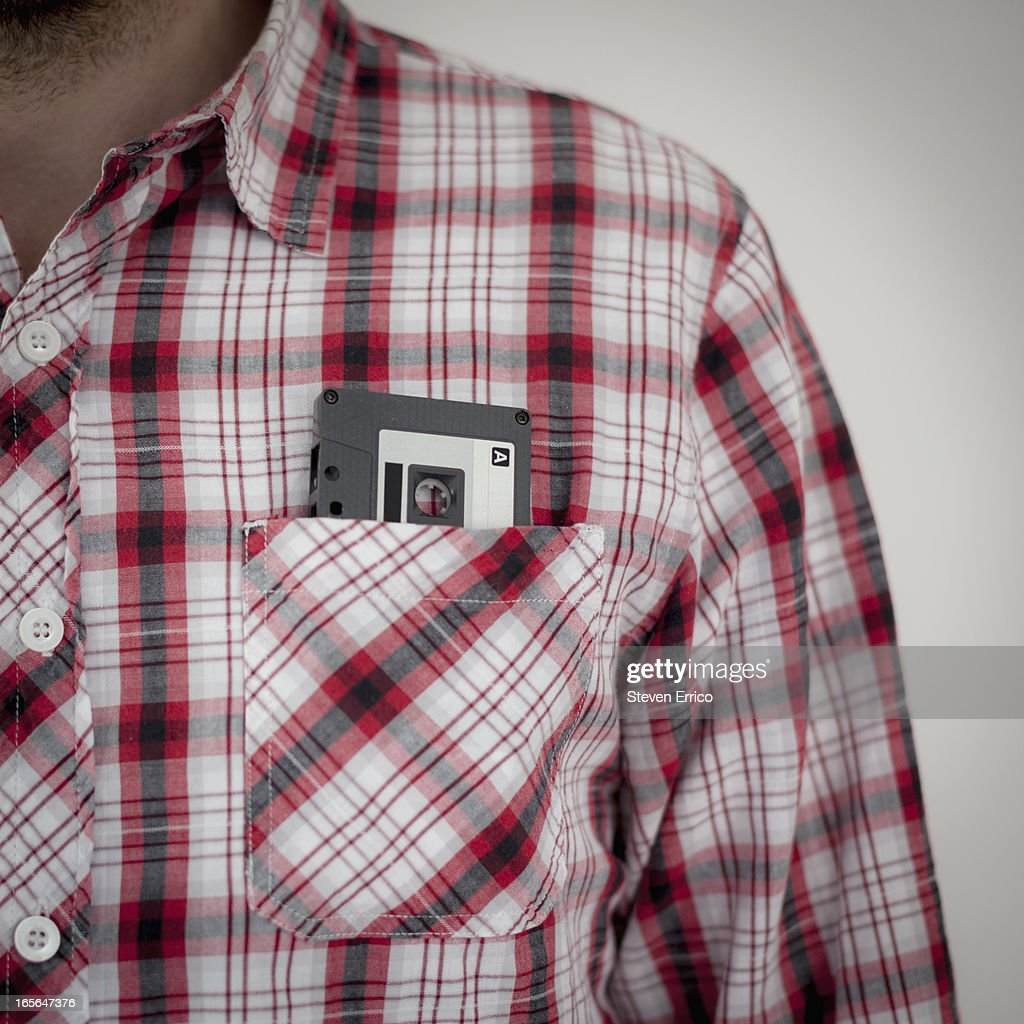 Man in plaid shirt with cassette tape in pocket : Stock Photo