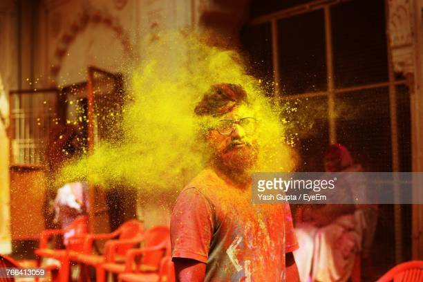 man in powder paint during holi - holi stock pictures, royalty-free photos & images
