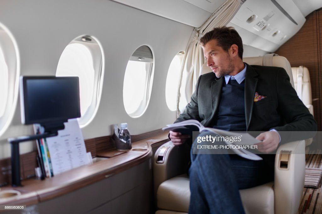 Man in private jet airplane : Stock Photo