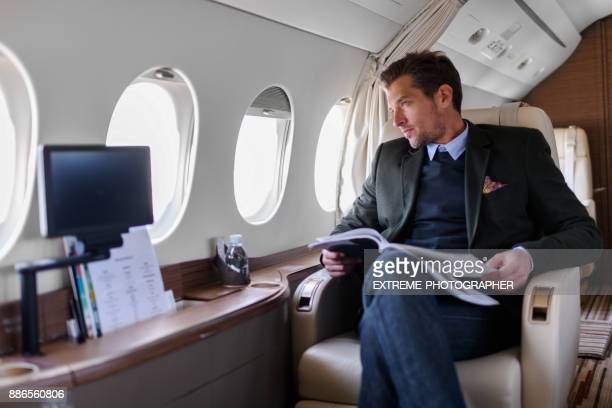 man in private jet airplane - aeroplane stock pictures, royalty-free photos & images