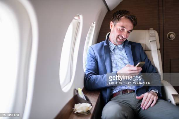 Man in private jet airplane