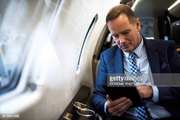 man in private jet airplane - wealth stock pictures, royalty-free photos & images