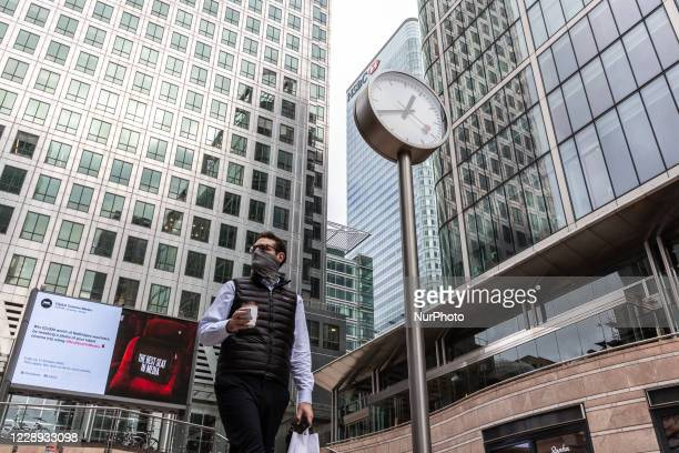 Man in protective face masks is seen during their lunch break at Canary Wharf financial skyscrapershub as the secondwave of Coronavirus hits...
