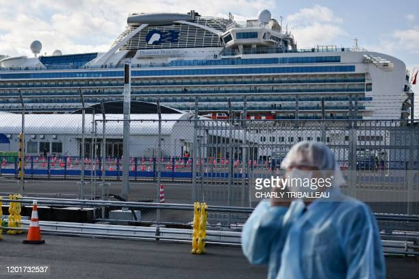 A man in protective gear speaks on the phone near the Diamond Princess cruise ship in quarantine due to fears of the new COVID19 coronavirus at the...