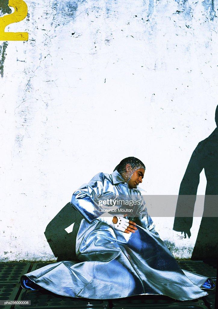 Man in protective suit lying on floor : Stockfoto