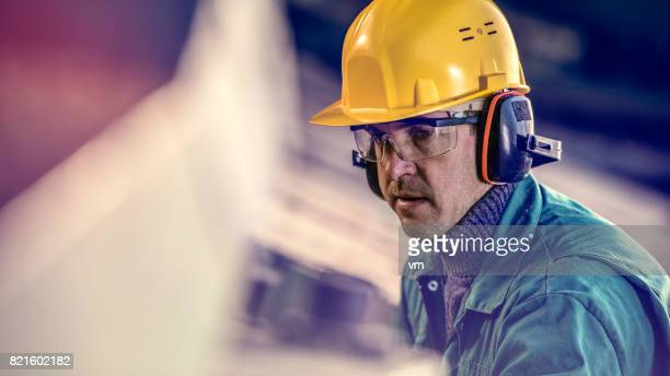 man in protective workwear - ear protection stock pictures, royalty-free photos & images