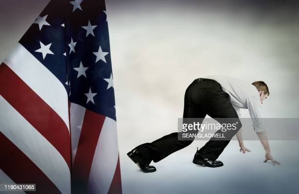 man in race position with usa flag - presidential candidate stock pictures, royalty-free photos & images