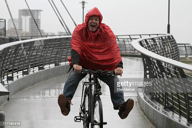 Man in rain on bike having fun