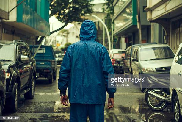man in rain - indonesia stock pictures, royalty-free photos & images