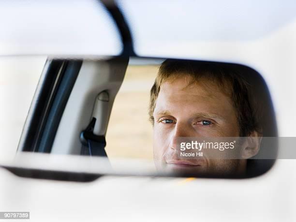 man in rearview mirror
