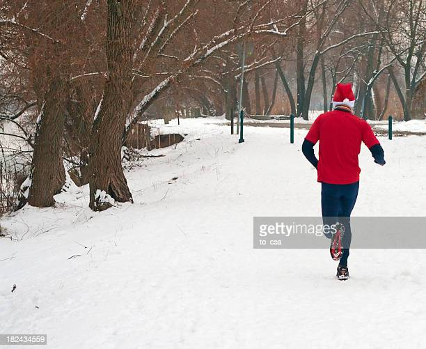 Man in red running in the snow