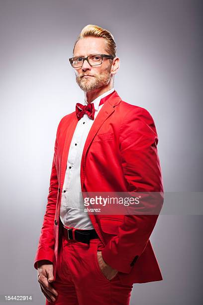 man in red suit - red suit stock pictures, royalty-free photos & images