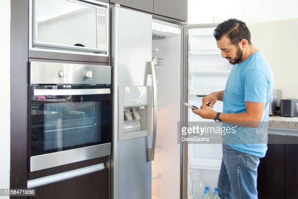 man in refrigerator - appliance stock pictures, royalty-free photos & images