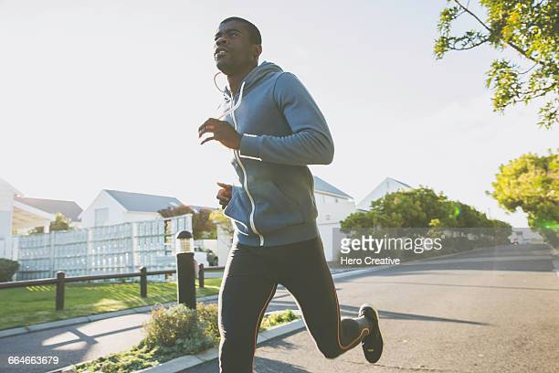 Man in residential area jogging