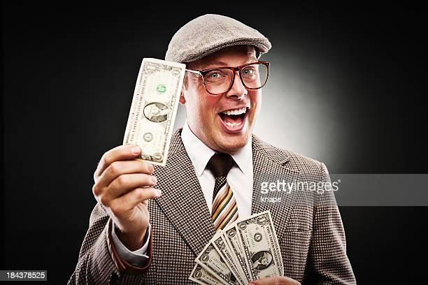 Man in retro suit giving money