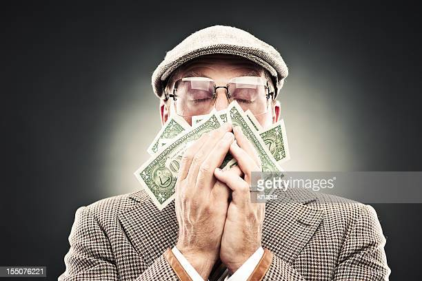 man in retro suit smelling money - ugly black men stock photos and pictures