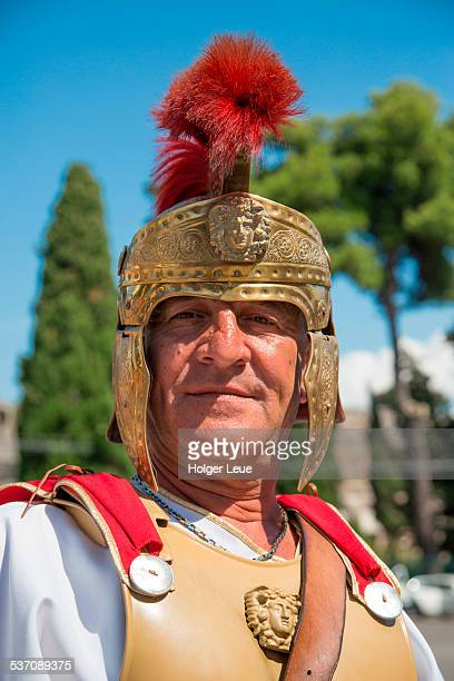 Man in Roman costume outside Pompeii ruins
