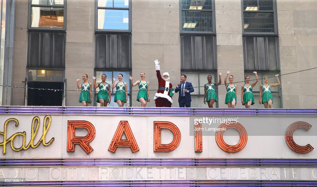 Man in Santa Claus costume and PLJ announcer John Foxx along with the Rockettes pose as The Radio City Rockettes Christmas In August 2017 perform on August 17, 2017 in New York City.