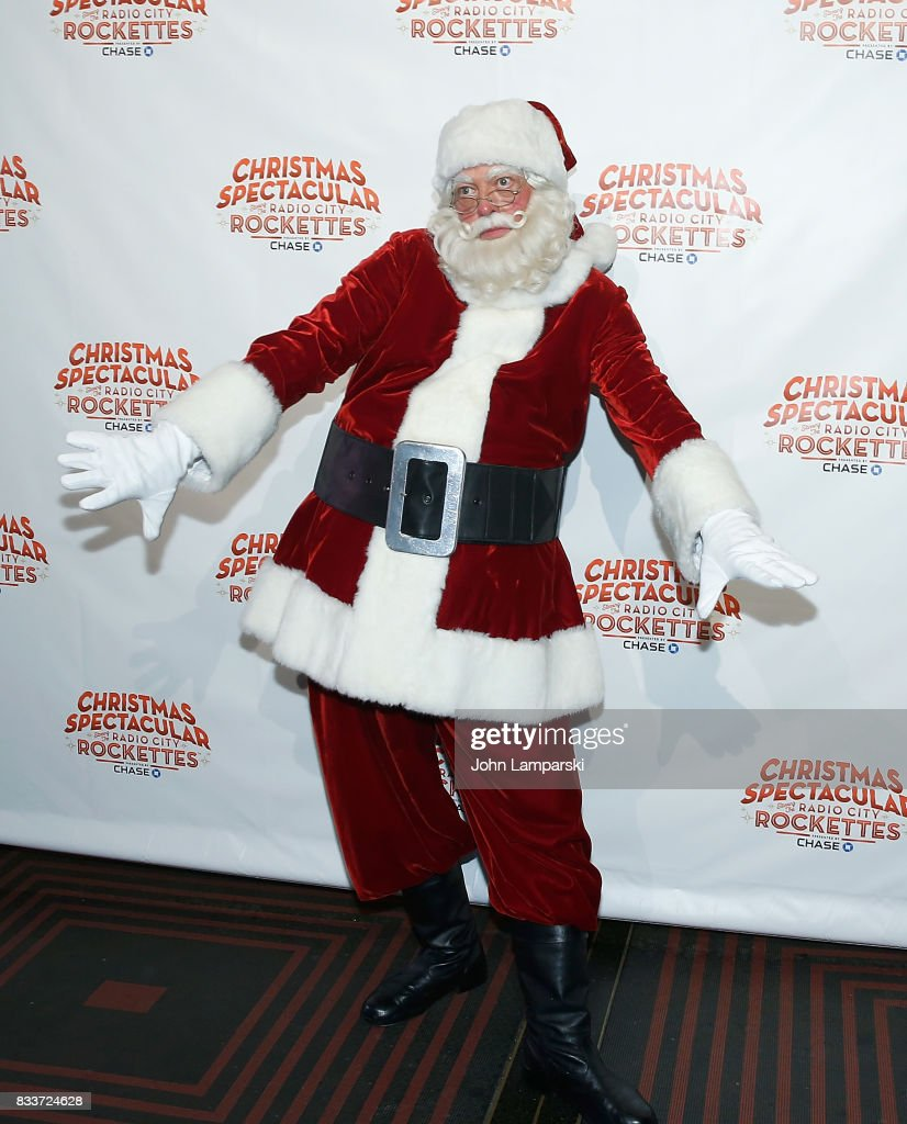 Man in Santa Claus costume poses as The Radio City Rockettes Christmas In August 2017 perform on August 17, 2017 in New York City.