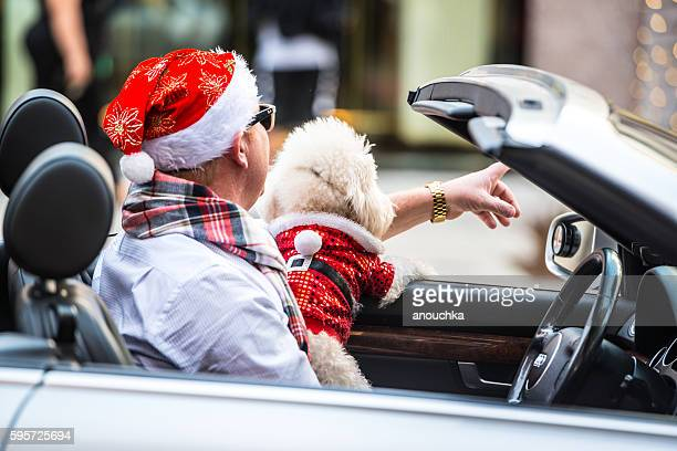 Man in Santa Hat driving Audi Cabriolet on Rodeo Drive