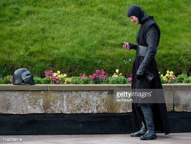 Man in Sci Fi costume checks his phone on the first day of the Scarborough Sci-Fi weekend at the seafront Spa Complex on April 06, 2019 in...